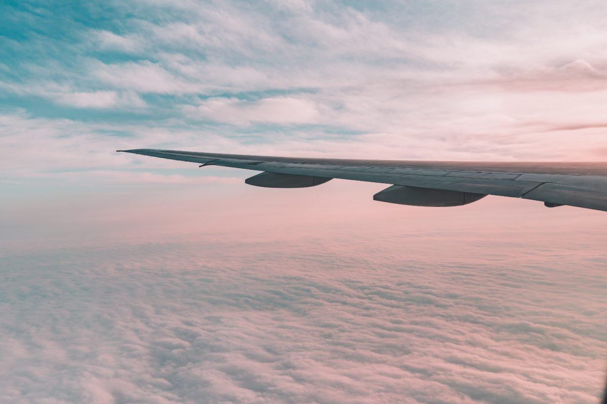 Wing of an airplane over the clouds